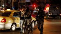 Jordanian riot policemen arrest a protester during a demonstration in Amman, Jordan