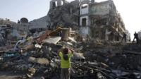 Palestinian children stand in the rubble left after an Israeli strike on a house in Gaza