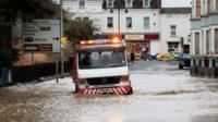 Recovery vehicle in flood water