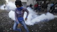 Protester and tear gas
