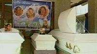 Coffins for three members of a family