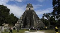 "Tourists are seen in front of the ""Gran Jaguar"" Mayan temple at the Tikal archaeological site in Guatemala"