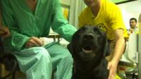 A dog and his owner visit a hospital patient