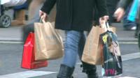 Woman with four carrier bags