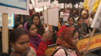 Women hold placards during protest in Delhi