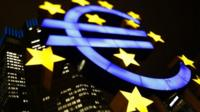 An illuminated euro sign