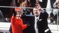 Nancy and Ronald Reagan wave at inauguration