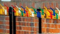 Empy coat pegs at a closed school