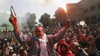The father of an al-Ahly fan who died celebrates with soccer fans