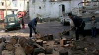 Syrians chopping wood
