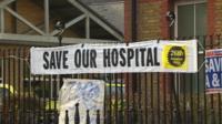 Banner proclaiming 'Save our hospital' outside Lewisham A&E