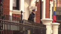 Police officer outside Ecuadorean embassy