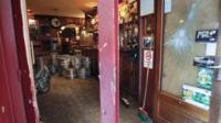 Smashed doors at The Smoking Dog pub