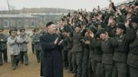 Kim Jong-un and members of the military