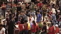 Supporters of Venezuela's late President Chavez viewing his coffin