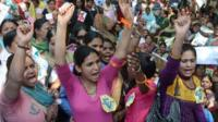 Indian women march to parliament during a protest rally