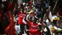 Supporters of Uhuru Kenyatta celebrate