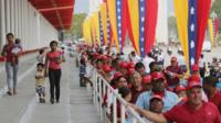Venezuelans queue to pay their respects to Hugo Chavez