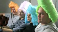 Inventors testing some brightly coloured wigs