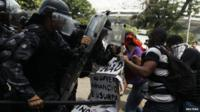 Supporters of a native Indian community living at the Brazilian Indian Museum clash with military police officers
