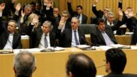 Cyprus lawmakers vote on key bills aimed at securing a broader bailout package from international creditors