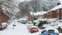 Cars are buried in deep snow in Mold, Flintshire, north Wales
