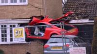 Audi embedded in Lowestoft house wall
