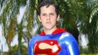 Hispanic man dressed as Superman