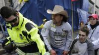 Injured man taken from Boston blast scene