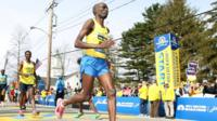 Wesley Korir warms up for Bposton marathon
