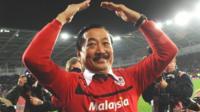Vincent Tan celebrates