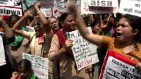 Women protesters with signs in Delhi