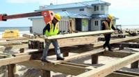Workers repairing the boardwalk in New Jersey Shore.