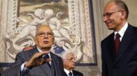 Italian Prime Minister-designate and deputy leader of the centre-left Democratic Party (PD) Enrico Letta (R)