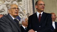 Italian Prime Minister-designate and deputy leader of the centre-left Democratic Party (PD) Enrico Letta (R) shakes hands with President Giorgio Napolitano at the Quirinale Palace in Rome on Saturday after the formation of a coalition government was announced