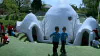 Children playing at soundproof domes