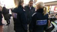 Paddy Tipping talking to PCSOs