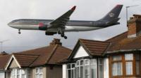 A plane flying over west London