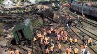 Emergency workers on the scene of the fire near Belaya Kalitva in southern Russia