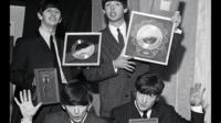 The Beatles pictured with silver discs in 1963