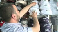 Man with 'Free Syrian Army' baseball caps