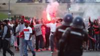 PSG supporters squaring up to riot police