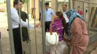 Woman and child stopped at border gate