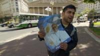Man advertising Pope Francis bus tours