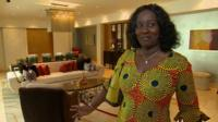 Ghanaian woman in luxury Accra apartment