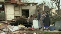People searching through a damaged building