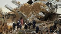 Rescue workers comb through debris at Plaza Towers Elementary School in Moore