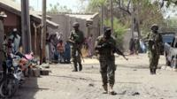 Nigerian troops patrol northeast town of Baga on 30 April 2013.