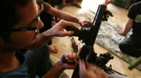 Opposition fighter with gun