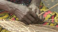 Woman's hands weaving